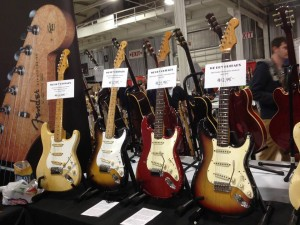 '57 blonde and 2-tone sunburst Strats, and '65 candy apple red and 3-tone sunburst Strats on display at We Buy Guitars.