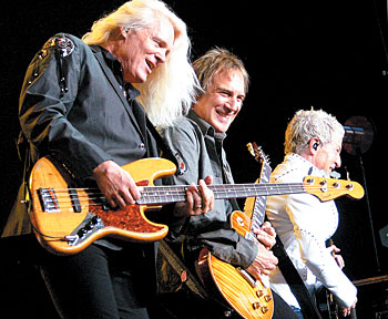 "Hall and ""Butter"" onstage with REO Speedwagon bandmates Dave Amato (center) and Kevin Cronin."