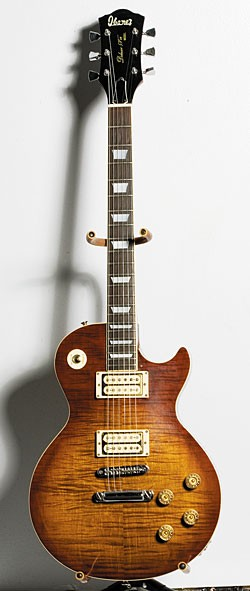 Late-'70s Deluxe 59'er Model 2340 with figured maple top in Dark Cherry Sunburst with pickguard removed.