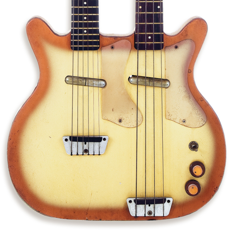 "Model 3923 Double-Neck. The Danelectro catalog called this finish White Sunburst, but its common name among collectors is ""copperburst."" Note the parallel pickups, duplicate clear pickguards, and how the bass neck joins the body at the 14th fret instead of the 13th."