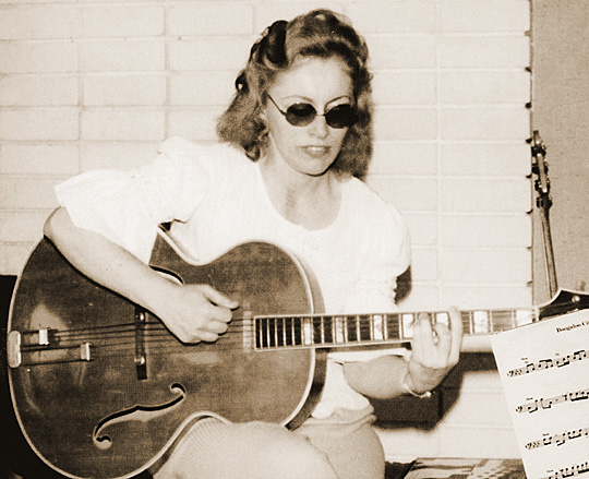 1971: Kaye in her teaching mode, comping on her Epiphone Emperor Carol Kay,  Vintage Guitar magazine