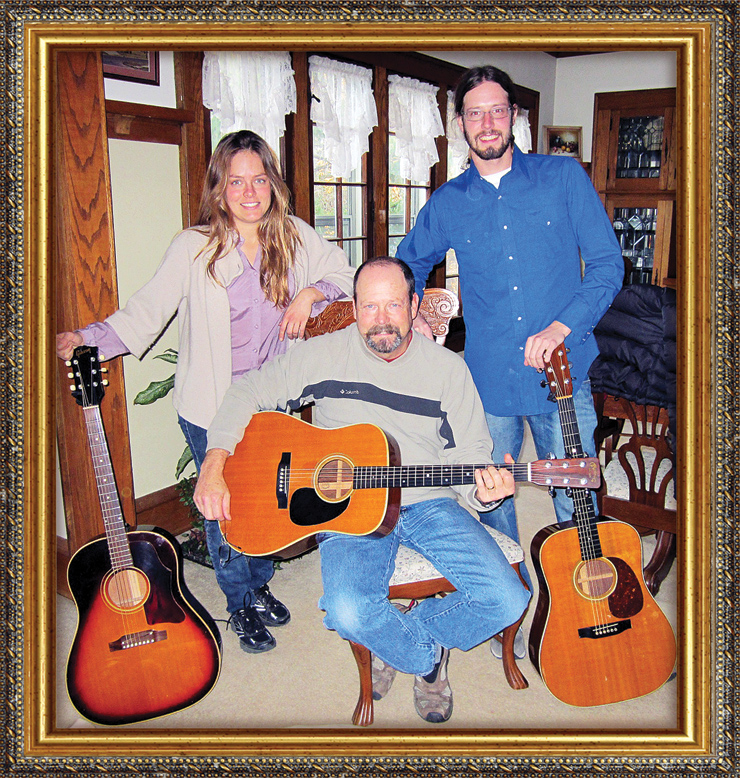 "Here are Christy and David Hays with their father, Steve, and a few of the family's guitars – a '63 Gibson J-45, '66 Martin D-28, and and early-'70s Martin HD-28.  ""Dad has been [very] influential touting the coolness of music and old guitars in our lives,"" Christy told us. ""We grew up with a basement full of vintage guitars and amps, and some of my earliest memories are of the smell of the inside of a Les Paul case. When I was 14, dad gave me his '62 Gibson B-25; I am now a professional songwriter and it's still my preferred axe. My brother is an avid flatpicker and received his first Martin as a gift from my father when he graduated high school.  ""Mom and dad have fostered creativity, self-expression, and a deep appreciation for the joy music brings to our lives. I'd come home from school, dad would return from work shortly after and, with his Marshall stack in the basement, rattle the leaded glass three floors up!  ""Dad is a working man. He worked as a welder and slowly amassed his collection throughout life. He is not a wealthy man who collects because of nostalgia; his collection is built on a foundation of deep admiration and love of the instrument and all of its incarnations. And, the stacks upon stacks of Vintage Guitar magazines that have been coming to my parents house for 20-plus years are a testament to his love of the vintage-guitar culture. ""Dad is also a luthier, and last Christmas gifted my brother and I with his custom Hays Handcrafted Thin Lines. He cut down the maple and walnut trees."""