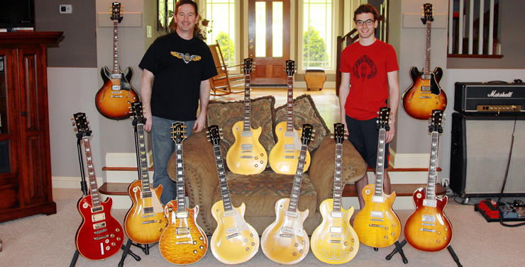 """Don Newman sent this shot of him with his youngest son, Jeff, and some guitars they assembled for their own """"Les Paul Day."""" """"Among others, there are a '53 goldtop, '55 all-gold, '57, and a bunch of newer ones,"""" Don said.""""There's also a '59 dot ES-335 and a '66 ES-335. And, that's an early JMP on a Marshall 4x12 with the original creambacks."""""""