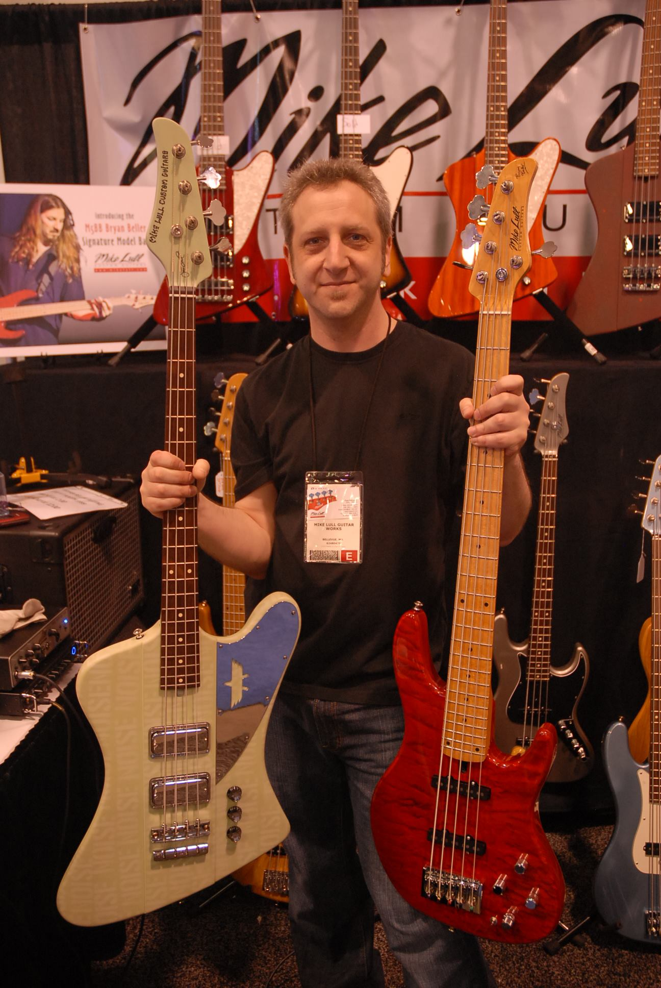 Mike Lull Custom Guitars GM Paul Schuster with Jeff Ament (left) and Bryan Bellers signature basses.