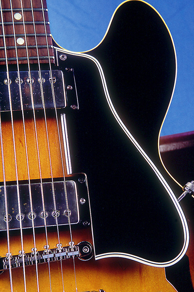 The long pickguard, nickel-plated Patent-Applied-For humbucking pickups and mouse-ear-shaped cutaways of the early 335.