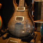 "PRS Custom 24 with the company's new uncovered 59/09 pickups, which have cool contoured bobbins that arc with the strings to deliver what the company calls a ""…more spread out, open tone."""