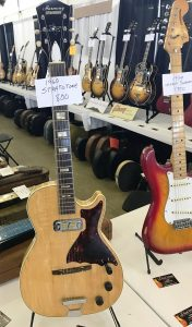 A 1960 Harmony Stratotone and a '79 Fender Strat