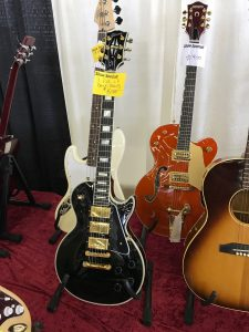 A Les Paul Black Beauty and a Gretsch 6120