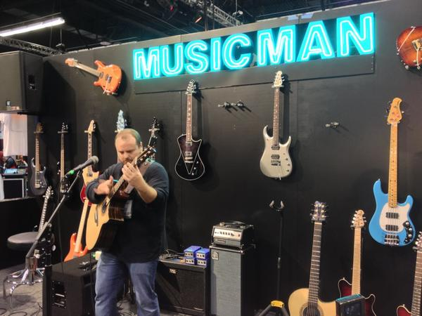 Andy McKee performing at the Ernie Ball booth