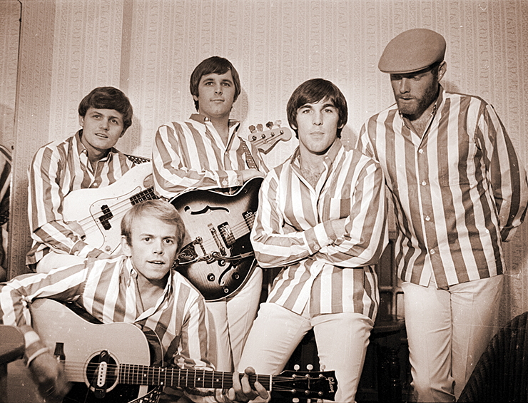 The Beach Boys in their trademark striped shirts prior to a concert in their glory year of 1964. Photos courtesy of Capitol Photo Archives.
