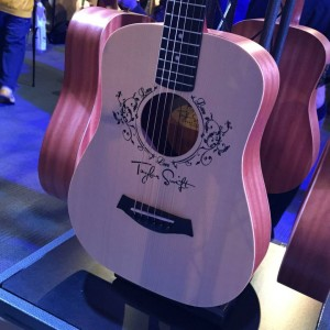 A Baby Taylor Swift hangs out on the Baby Taylor display in the Taylor Guitars #NAMM2015. #vintageguitar #guitarlove #TaylorGuitars #TaylorSwift #guitars #NAMM15 #NAMMshow #NAMM — in Anaheim, California.