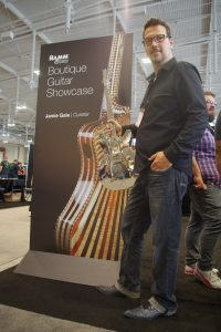 NAMM dedicated a display boutique builders. Here's curator Jamie Gale with a polished aluminum beauty.