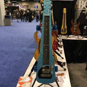 In California Ocean Blue Flake with wheels and dice details, this BGF Original Lap Steel from Brown's Guitar Factory is definitely a unique addition to any #guitar lover's collection. #NAMM2015 #steelguitar #guitarlove #vintageguitar #NAMM15 — in Anaheim, California.