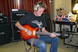 Guitarist Dana Olsen jamming at Fryette Amplification.