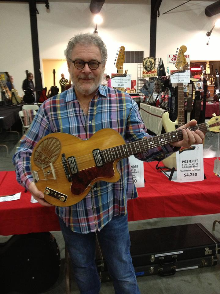 More Orange County Guitar Show. Fretted Americana's David Brass with a 1960 Hofner 126 Club 50 prototype with built-in amp and speaker.