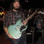 Doug Myer of Mountain Cat Guitars with a pelham blue SG