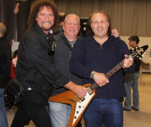 Drew Berlin with Dave Davidson and Richie Friedman of We Buy Guitars with a '58 Gibson Flying V.