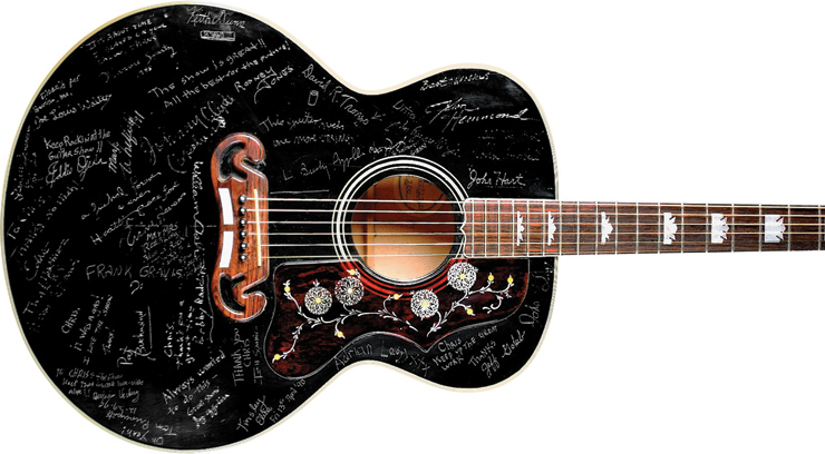 '88 J-200, replete with signatures carved into virtually every inch of their bodies, front and back.