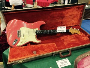 We found a 1962 Fiesta Red Strat. What's your favorite custom color? #Strat #vintageguitar #ocguitarshow #Fender — in Costa Mesa, California.