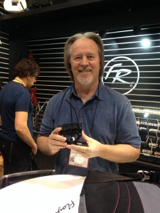 Floyd Rose holding his surface-mount model, the FRX.