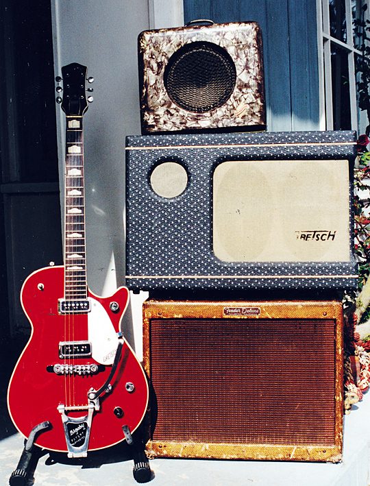 A 1957 Gretsch Jet Fire Bird with a 1946 Dickerson M.O.T., 1957 Gretsch Electromatic, and a 1958 Fender Deluxe amp.
