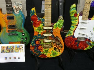 A guitar show like Guitarlington 2015 is going to have many custom guitars, like this Strat with artwork by Liz Elequin on display at G Z Guitars.