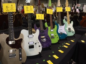 A row of new Suhr guitars at the Guitar Emporium booth at Guitarlington 2015.