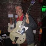 Joe Menza of Best Guitars with a Gretsch Silver Jet