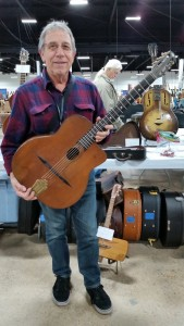Jacques Mazzaleni / Gypsy Guitars holding a 1940s Grand Modele (Du Passage).