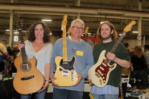 Janet Stites, Rick Hogue and Jon Bookstein of Garrett Park Guitars with an Olson 2002 acoustic, a new Fender Custom Shop Junkyard Dog '51 Tele (limited edition run for Garrett Park Guitars), and 2004 Fender Custom Shop John Cruz Strat