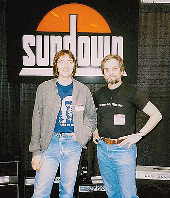 Kager with Allan Holdsworth in the Sundown Amplifiers booth at the '86 NAMM show.