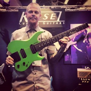 Jeff Kiesel with the new #Kiesel Vader seven-string in a matte Kiesel Racing Green finish! This beauty weighs in at only six pounds. #vintageguitar #Carvin #guitar#guitars #NAMM15 #NAMM2015 #vintageguitarmagazine