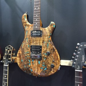 Yes, you're seeing spots on this First Severn with spalted top and inlaid stone - spots of real turquoise! Learn more about this Tier 3 Trembuck atKnaggsGuitars.com. #knaggsguitars #guitar#vintageguitar #NAMM2015 #NAMMShow #NAMM15#NAMM — in Anaheim, California.