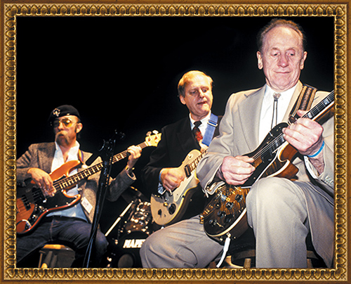 Les Paul onstage with Del Casher (center) and Skunk Baxter during his 80th party at the Gene Autry Museum. Photo by Rick Gould.