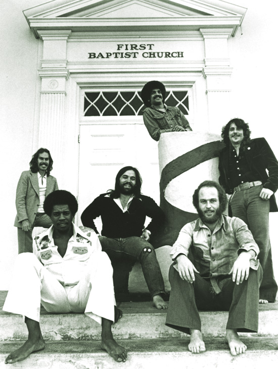 Little Feat, barefooted with guitarists Lowell George (center) and Paul Barrère (right front). Little Feat: courtesy Warner Brothers Records.