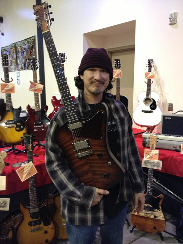 SoCal World Guitar Show - Luthier Gabriel Currie with one of his creations.
