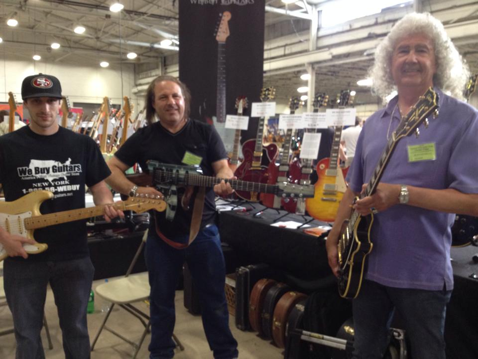 Mike and Richie Friedman, and Tom Dubas from We Buy Guitars with a blonde '57 Strat, prototype Jackson machine guitar, and '59 triple-pickup Les Paul Custom.