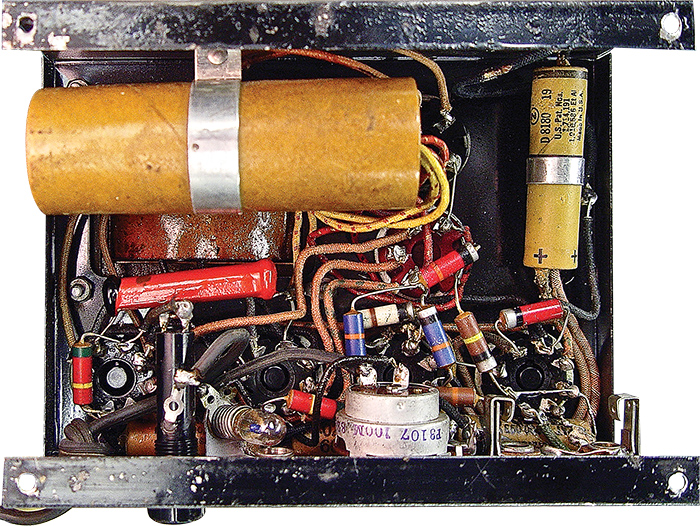 Very few internal components – including the massive filter capacitor in the brown cardboard tube – resemble anything you'll find in a contemporary amplifier, other than maybe the pilot light and the fuse socket.