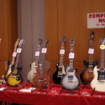 A table full of entry-level vintage guitars