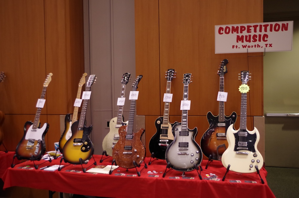 "A table full of entry-level ""vintage"" guitars"
