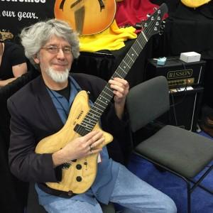 Don Latarski showing off one of Ralph Novak's Fan Fret guitars. #NAMM2015? #VintageGuitar #NovaxGuitars #Novax — in Anaheim, California.