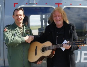 Vintage, Paul Brett donate guitar to RAF squadron.
