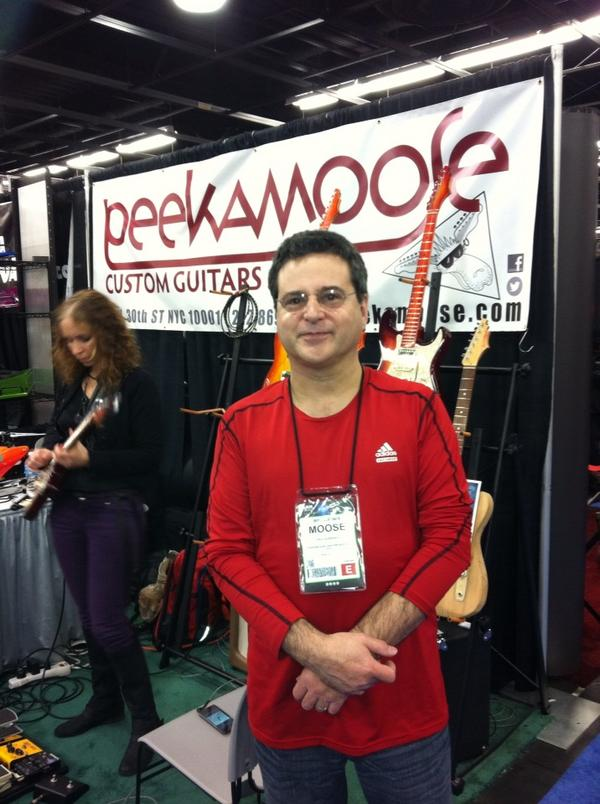 Paul Schwartz with Jane Getter(background) at the Peekamoose booth.