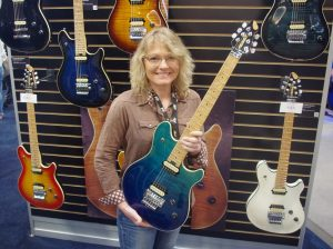 Peavey's Dana Cox displays the flagship HP-2, one of its new models made in Mississippi.