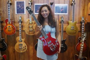 Anita Agopyan-Miu with the Bigsby-equipped version of Prestige Guitars' new DC Coup.