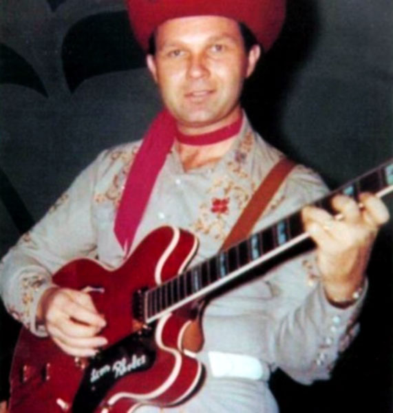 Leon in full Texas Troubadours stage attire with his cherry red Epiphone Sheraton