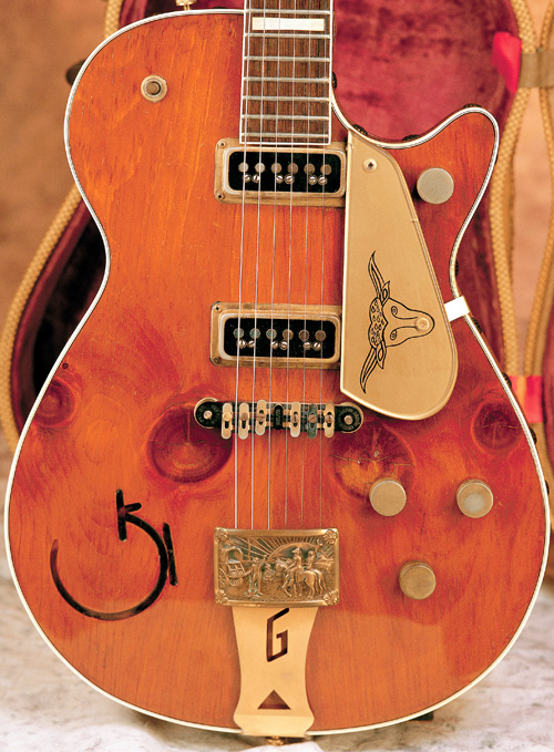 The1954 Round-Up with knotty-pine top. The pickguard and the truss-rod cover on this '54 do not appear to be original.