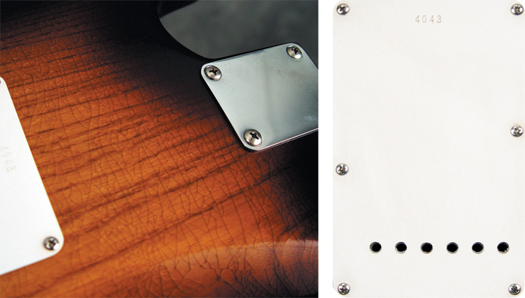 "The Custom Shop ""Closet Classic"" finish is weather-checked, but not ""beat up.""  And The 50th Anniversary's trem cover plate has period-correct round holes."