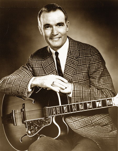 Smith with his signature model Gibson. Johnny Smith courtesy of Mel Bay Publications.