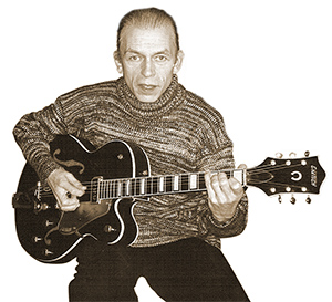 Steve Howe with a Gretsch Custom. This guitar belonged to Chet Atkins c. 1960. It has added pieces at the end of the fingerboard, beneath the 5th and 6th strings, which was part of an octave divider effect.